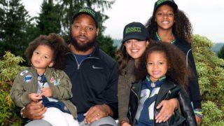 Michael Bennett and his family in Bennett Foundation swag