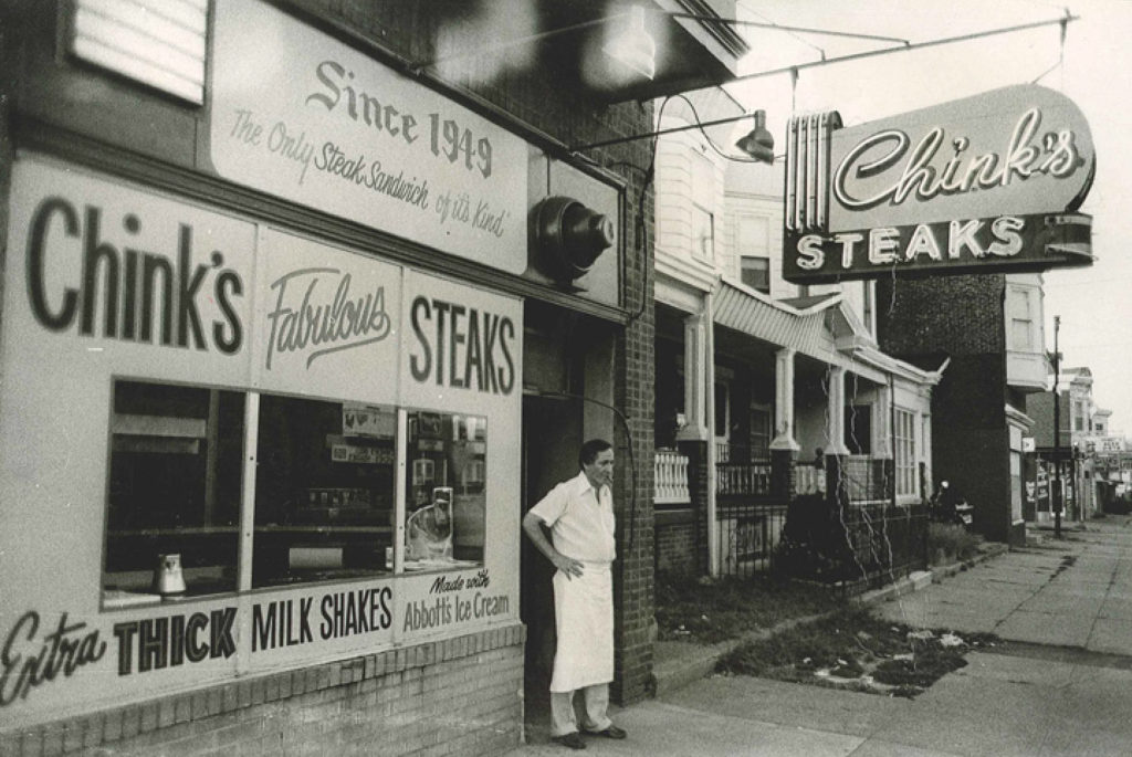 Samuel 'Chink' Sherman outside his cheesesteak shop on Torresdale Avenue