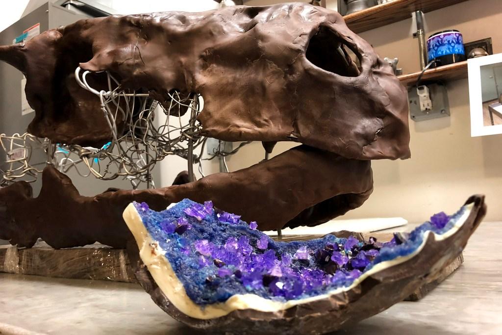 An edible dinosaur skull and edible geode