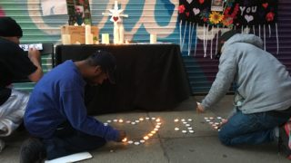 Attendees help light candles to remember John Paul, who died of an overdose last Friday.