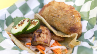 Pork belly taco and empanada from Street Food Philly — whose owners now operate Revolution Taco