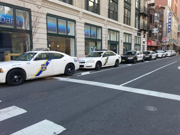 A row of Philly cop cars blocking 13th Street and Arch in 2014