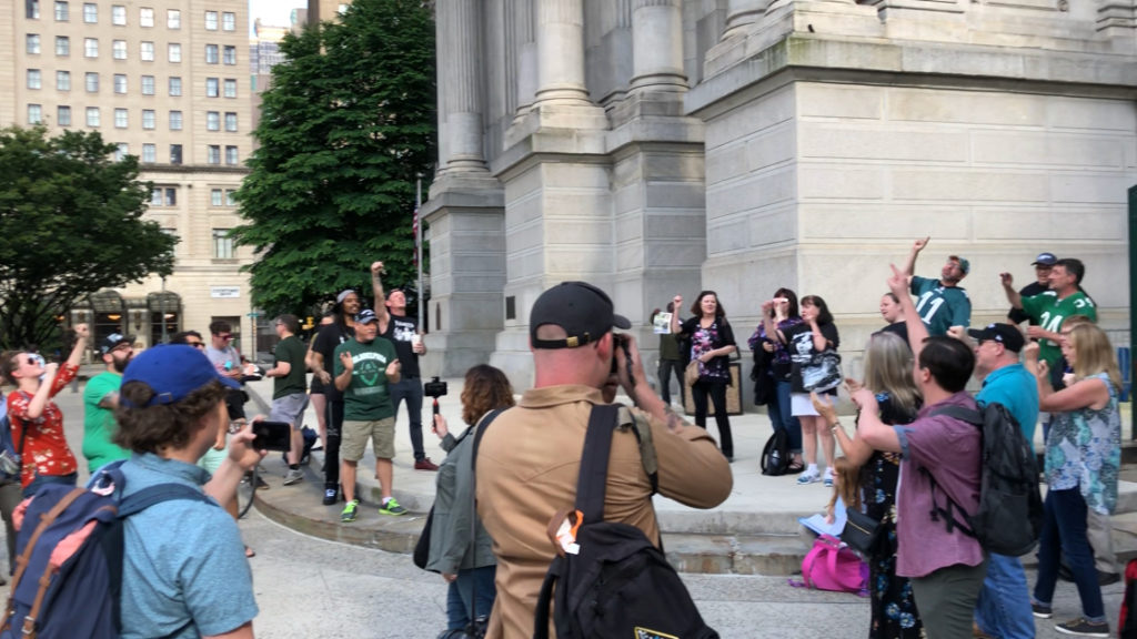 An impromptu rally at City Hall drew several dozen Eagles fans