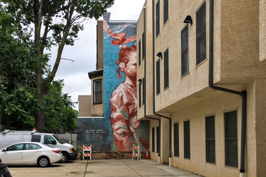 A mural titled 'In Living Memory: Those of Us Alive' has been covered up by apartments at 15th and Berks streets