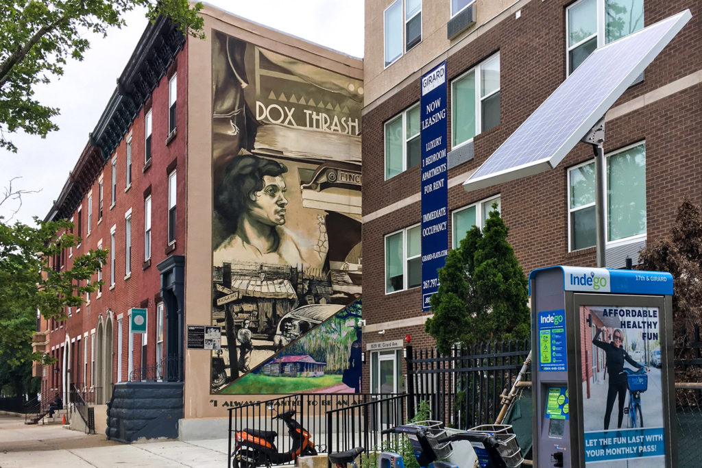 A mural commemorating famous African American printmaker Dox Trash used to be on display at 16th and Girard, now half-covered by a new apartment complex