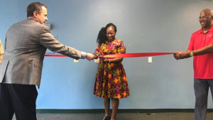 Jon Orens (left) cuts the ribbon alongside nonprofit workers, marking the opening of the Daniel J. Orens Center for Life