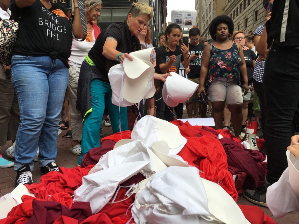 The handmaid costumes at Monday evening's protest of VP Pence