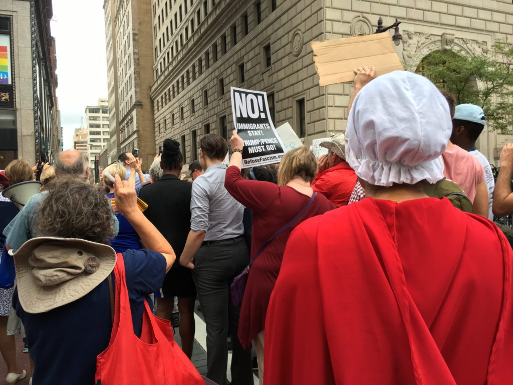 Dressed like a handmaid, Noel Pattani attended a protest outside the Union League while VP Mike Pence attended a fundraiser