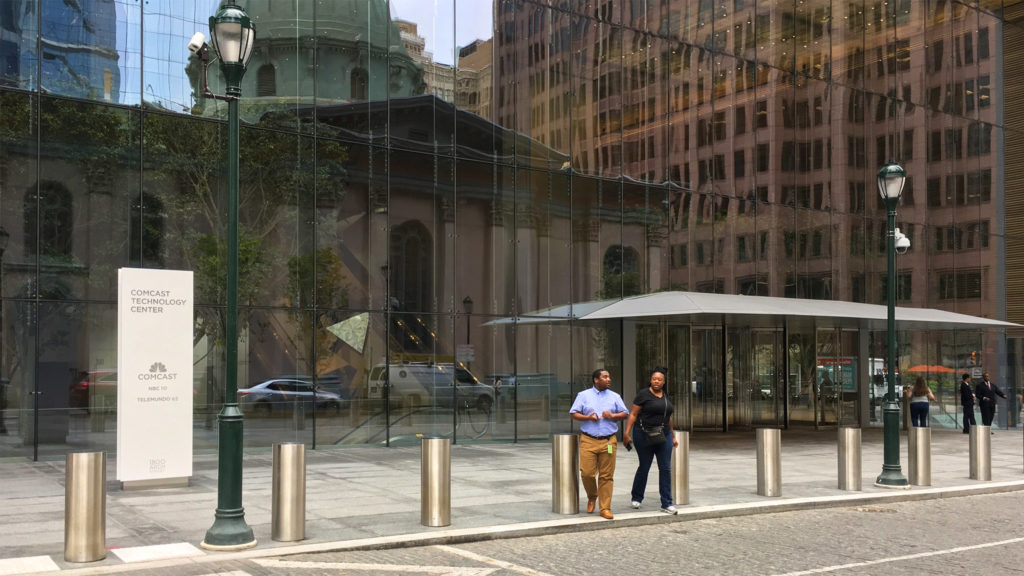 People were entering and exiting the Comcast Technology Center around lunchtime on Monday
