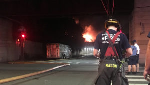 Firefighters battled a four-alarm blaze at a junkyard at Tulip and Somerset