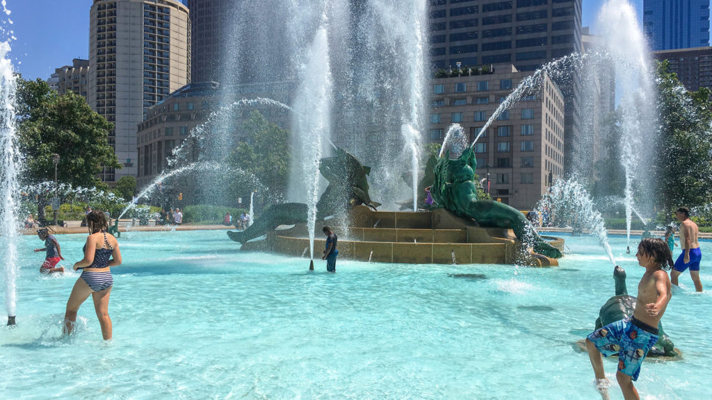 Kids swimming in the Swann Memorial Fountain — despite that it isn't actually allowed.