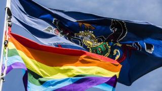 The LGBTQ flag flying alongside Pennsylvania's