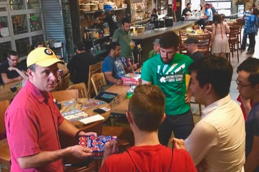 Hendricks (bottom left) hosts a game night at Evil Genius