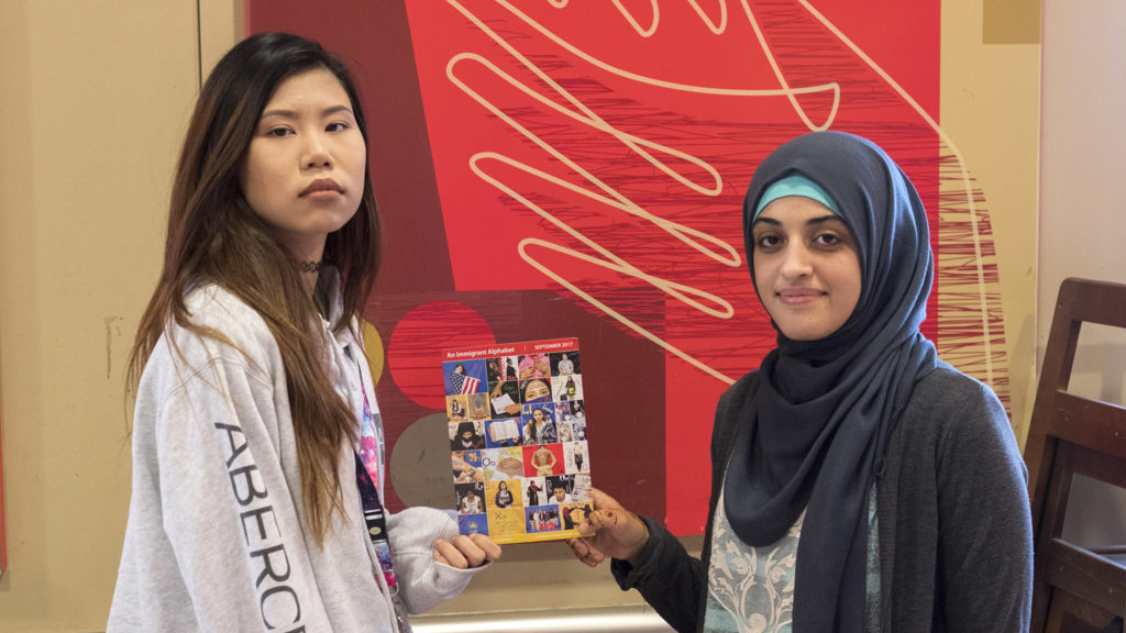 Jenny Lim and Doha Salah, NEHS grads who worked on the Immigrant Alphabet project