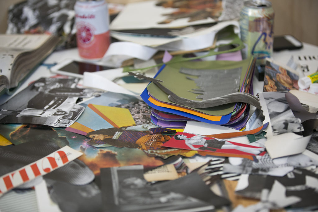 Materials for collages sit on the table at the Bok workspace