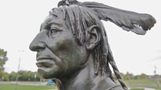 A Native American monument stands in Eakins Oval