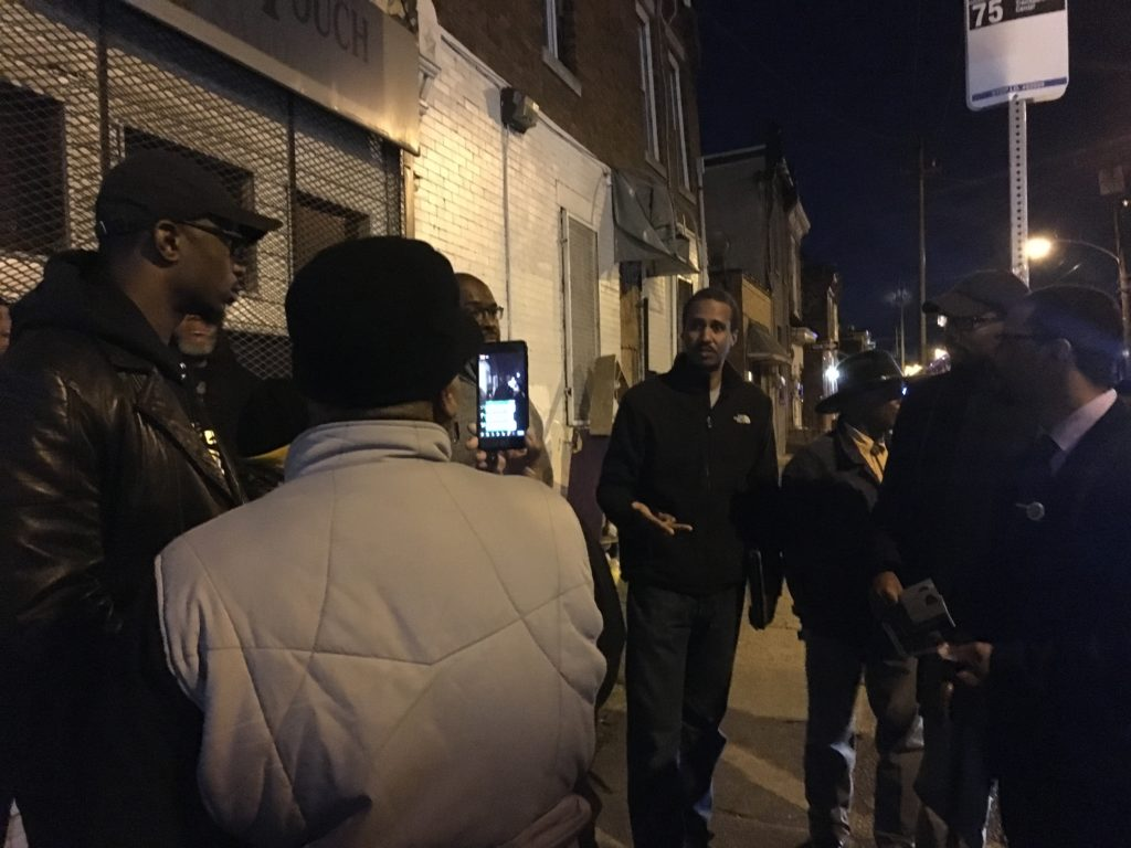 A Nicetown block captain streams a community event on Facebook Live.