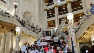 Supporters of a bill to abolish life without parole gather in the capitol rotunda.