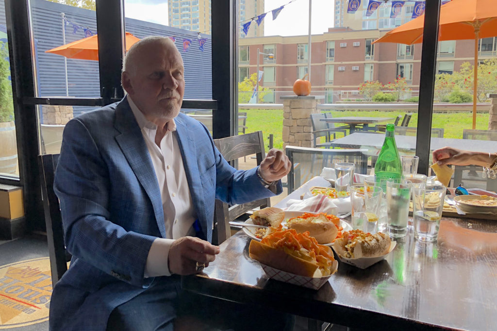 Flyers legend Bernie Parent with a ton of Gritty food in front of him