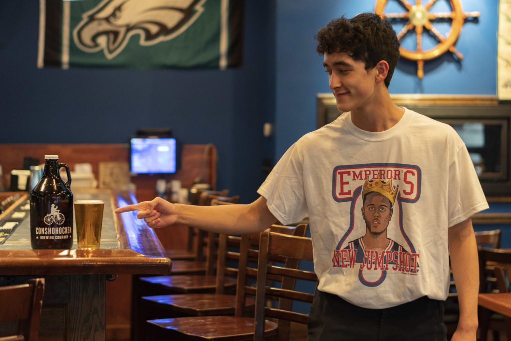 Fleming's son, Ethan Kerr, models the beer's Biggie-inspired t-shirt