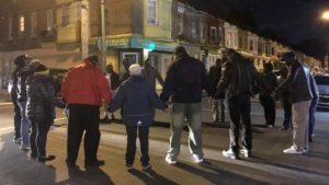 In October, neighbors concluded a Stand Up Nicetown! event with a prayer in the intersection of 17th and Wingohocking.