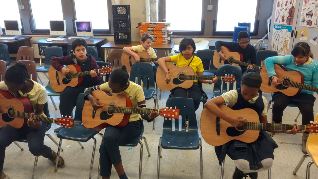 Philly students get to know guitars in one of Taber's music classes