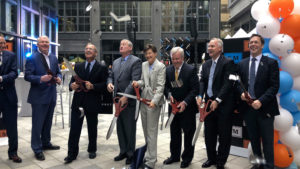 Mayork Kenney and other officials cut a symbolic ribbon at the East Market mixed use retail complex in Center City