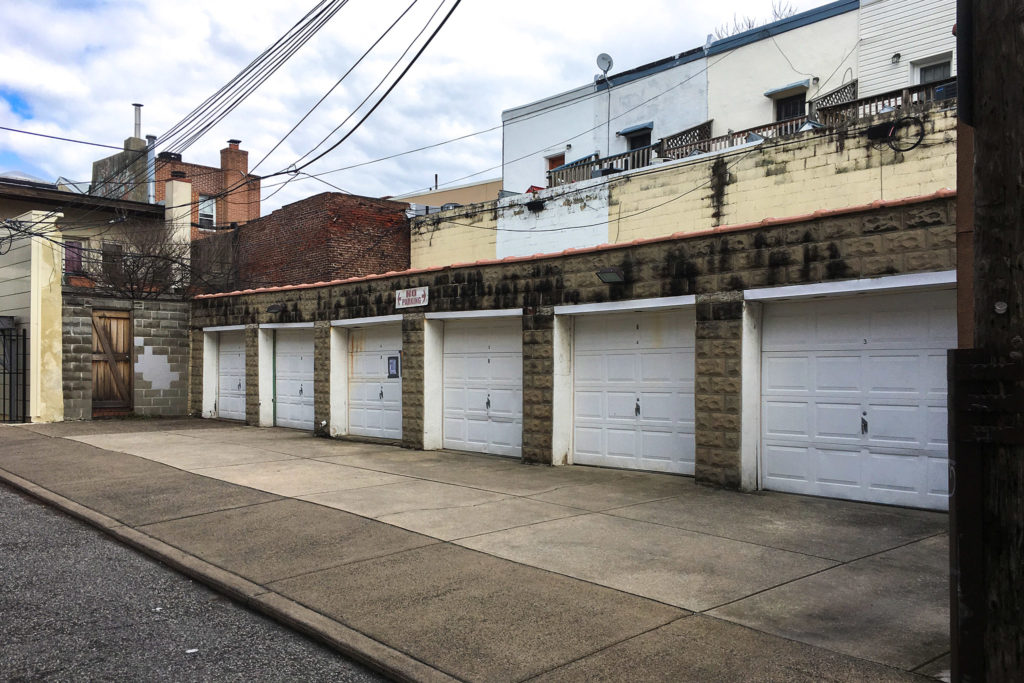 The garages at 729-33 Pemberton Street are up for development — and they're adjacent to a possible historic burial ground