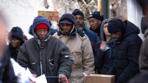 People line up for a January 2019 food giveaway in North Philly