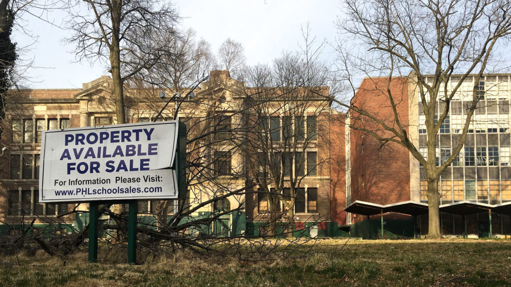 The closed Germantown High School, marketed by a for sale sign