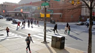 Students cross the street at Temple. Temple, Penn and other regional schools are closing campuses because of coronavirus concerns, making business unpredictable for restaurants near college campuses.