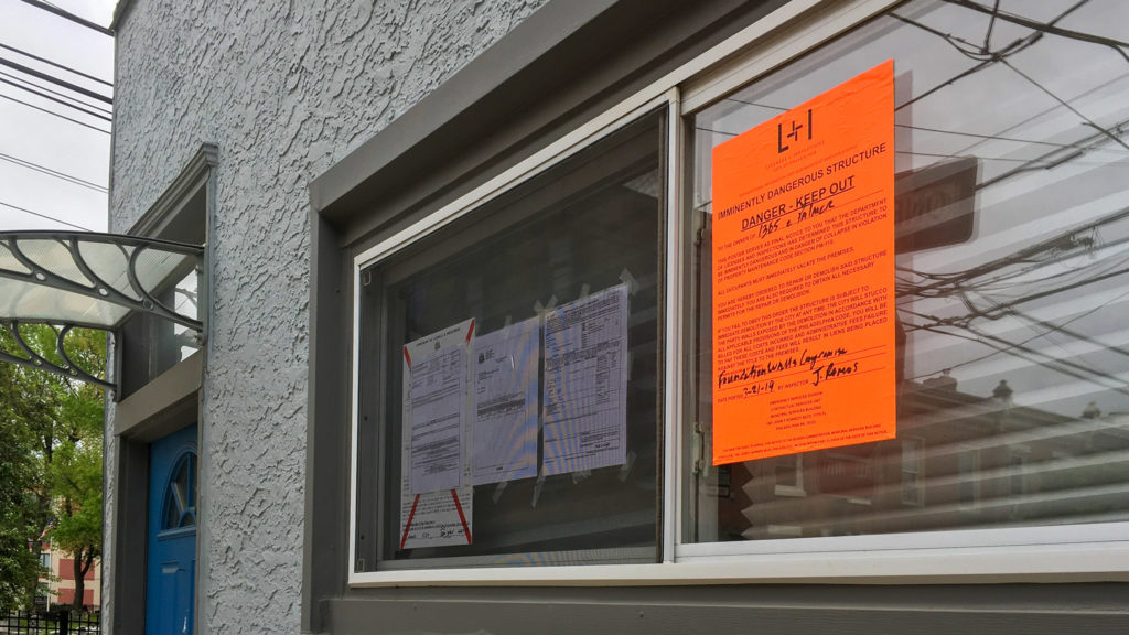 A notice deems the property at 1365 Palmer St. 'imminently dangerous'