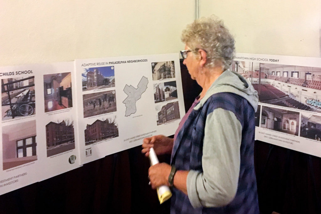 A neighbor explores the developer's plan for the shuttered Germantown High School building.