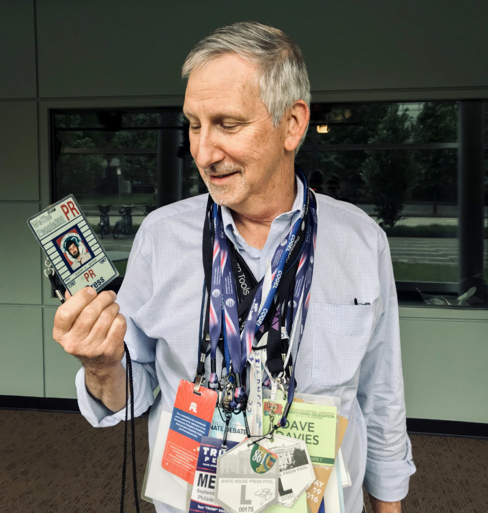 Dave Davies wearing part of his extensive collection of press passes