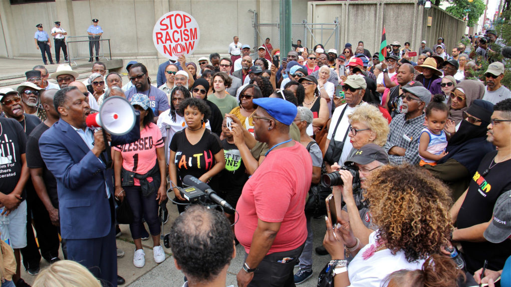 Hundreds protest at Philly police HQ, call for action on