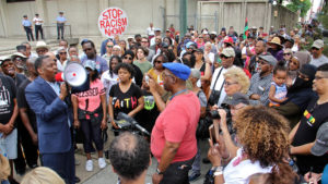 Protesters gather at Philadelphia police headquarters to call for action against police officers who posted racist comments on Facebook