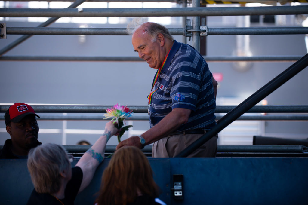 Former Evva Chambers handed a flower to former Gov. Ed Rendell, who was a Grand Marshall of parade