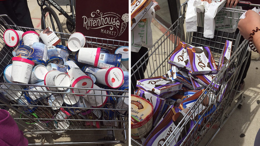 Shopping carts filled with free frozen treats outside Rittenhouse Market on Saturday
