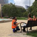 Pre-heat wave, Kevin Riordan (left) and Carrie Wagner offer services to a person experiencing homelessness.