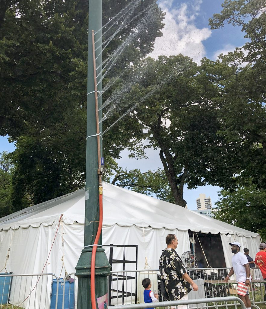 A makeshift sprinkler kept festival-goers cool