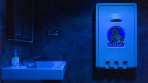 Blue lights bathe the bathroom at a Center City Starbucks