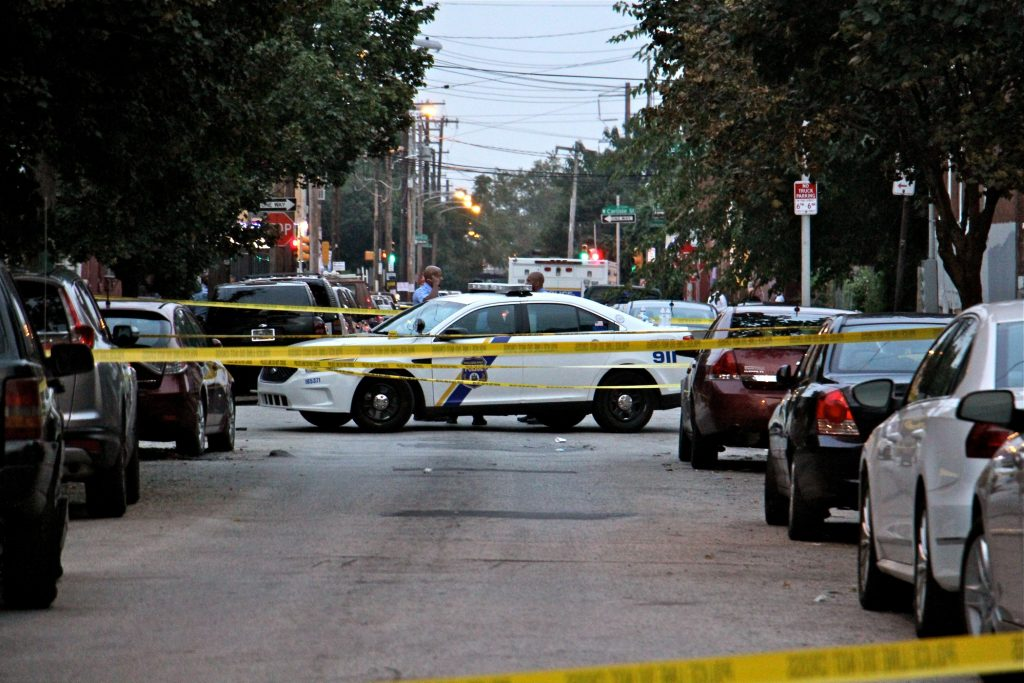 Police cordon off an area in North Philadelphia around 15th Street and Erie Avenue, where a gunman opened fire on police. (Emma Lee/WHYY)