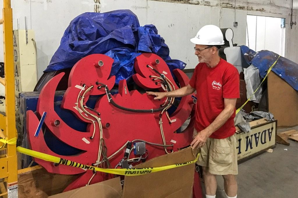 Museum founder Len Davidson shows off his crab