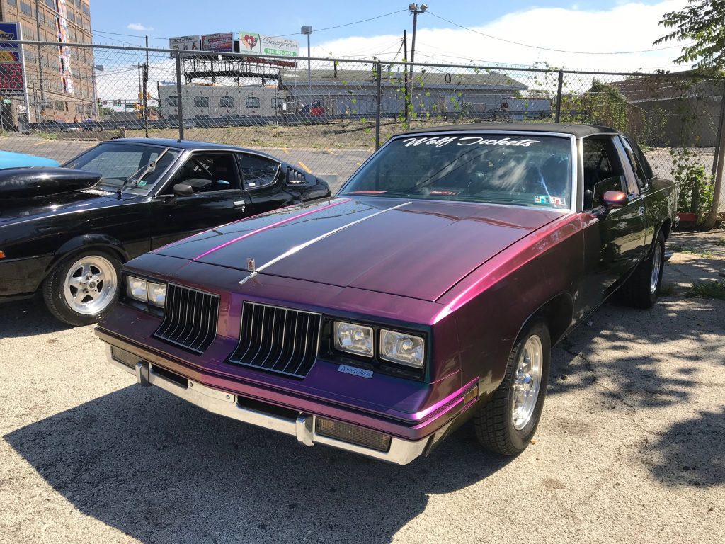 "Car show-goer Steve Logan's '82 Oldsmobile Cutlass is called ""Wolf Tickets"""
