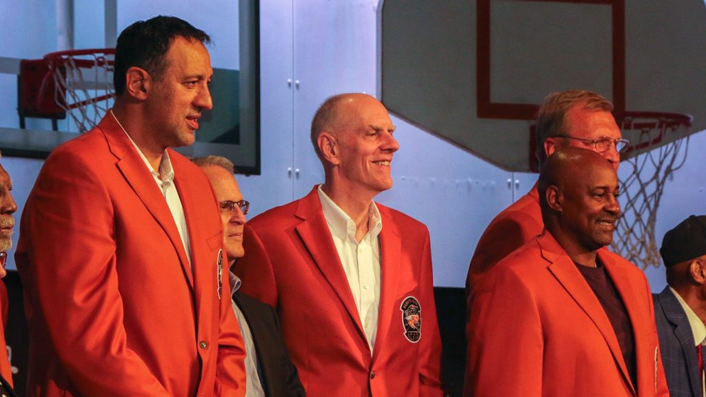 Retired Sixer Bobby Jones (center) at the jacket ceremony for his Hall of Fame induction