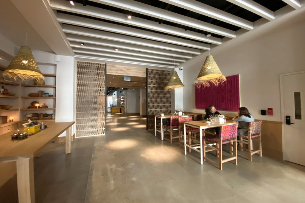 El Cafe has a few tables. Behind it is Condesa