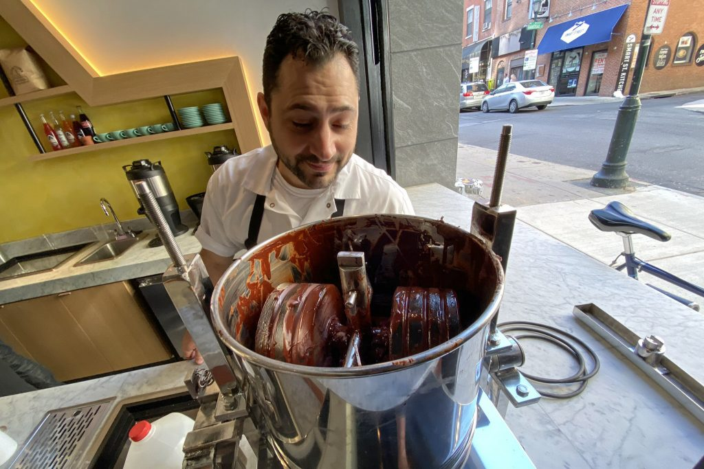 Pastry chef James Matty overlooks his chocolate, ground in house from cacao beans