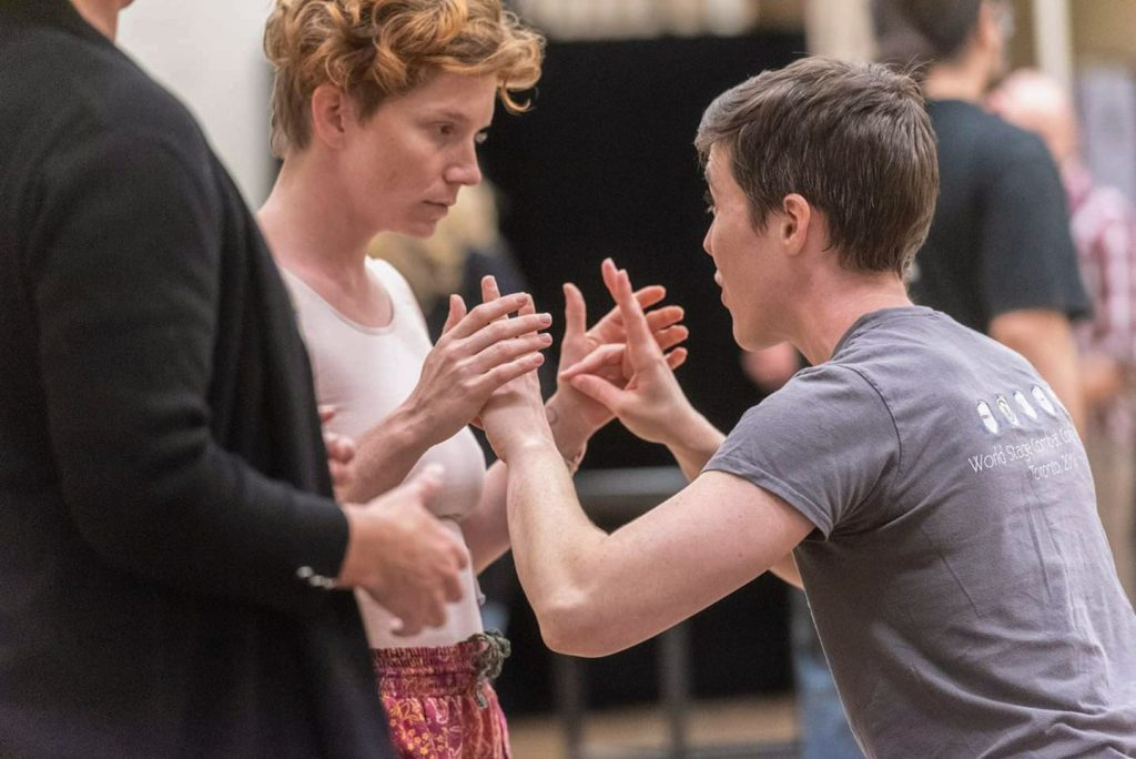 Intimacy director Eli Lynn works with actors at a University of Illinois intensive