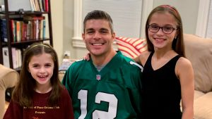 The author and his daughters, who are also both Eagles fans