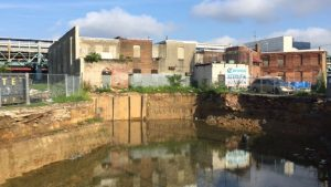 Residents were kayaking on this 'pool' that formed in a construction ditch